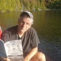 Martin St. Andre reading in the waiting landscape of Ste-Beatrix, Quebec