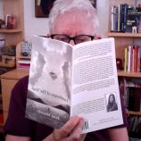 Penelope Starr reads my book in Tucson, Arizona while her looms over her shoulder