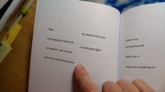 "In Oakland, CA, beloved endorser, Rusty Morrison points to pages 8-9 of the opening poem, ""Fracture"""